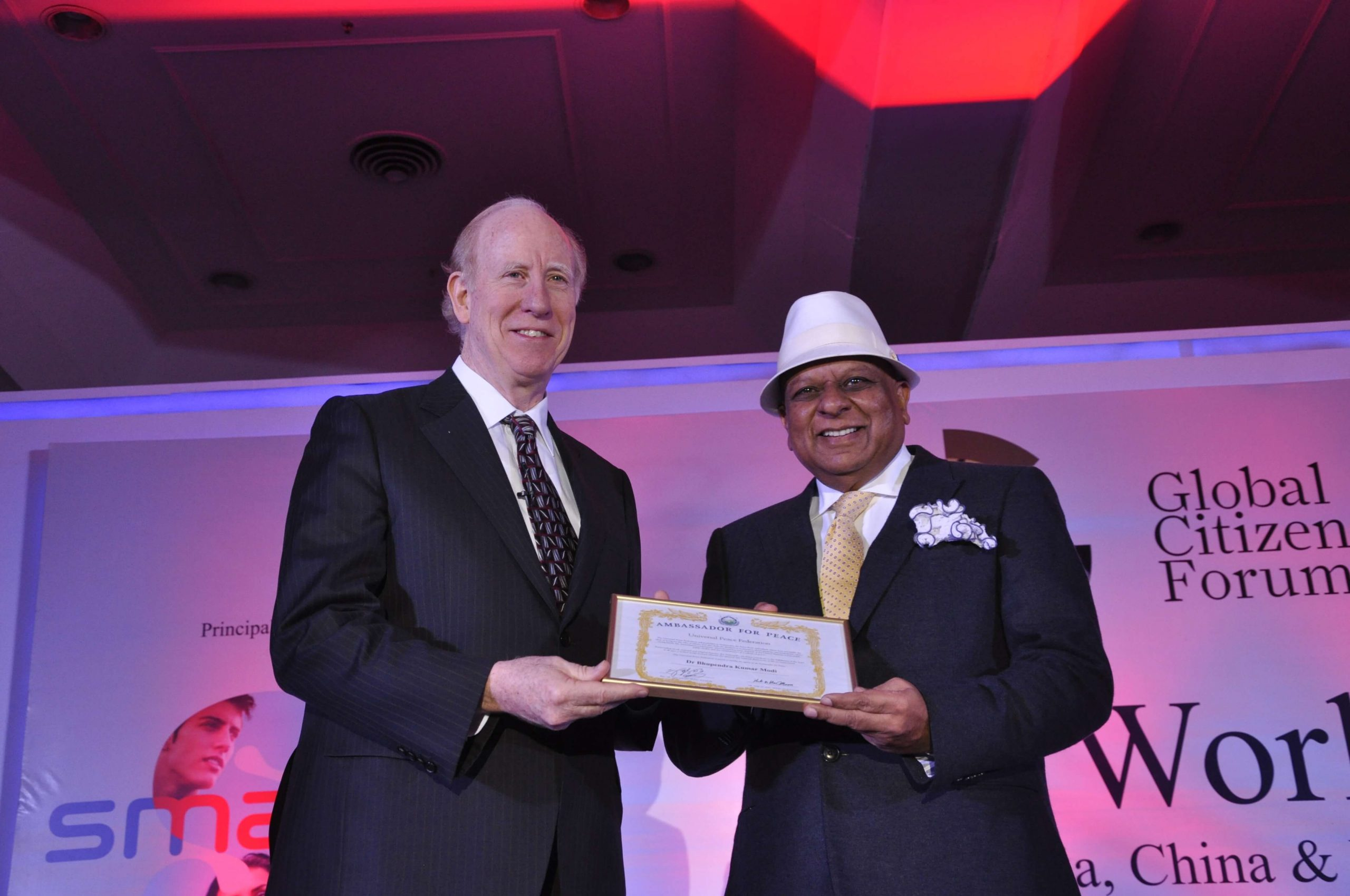 Dr. M receives the Ambassador for Peace award by the Universal Peace Federation